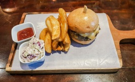 Refinery burger with fries, coleslaw and a dash of salt